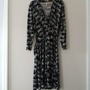 Knee length black and white leopard wrap dress